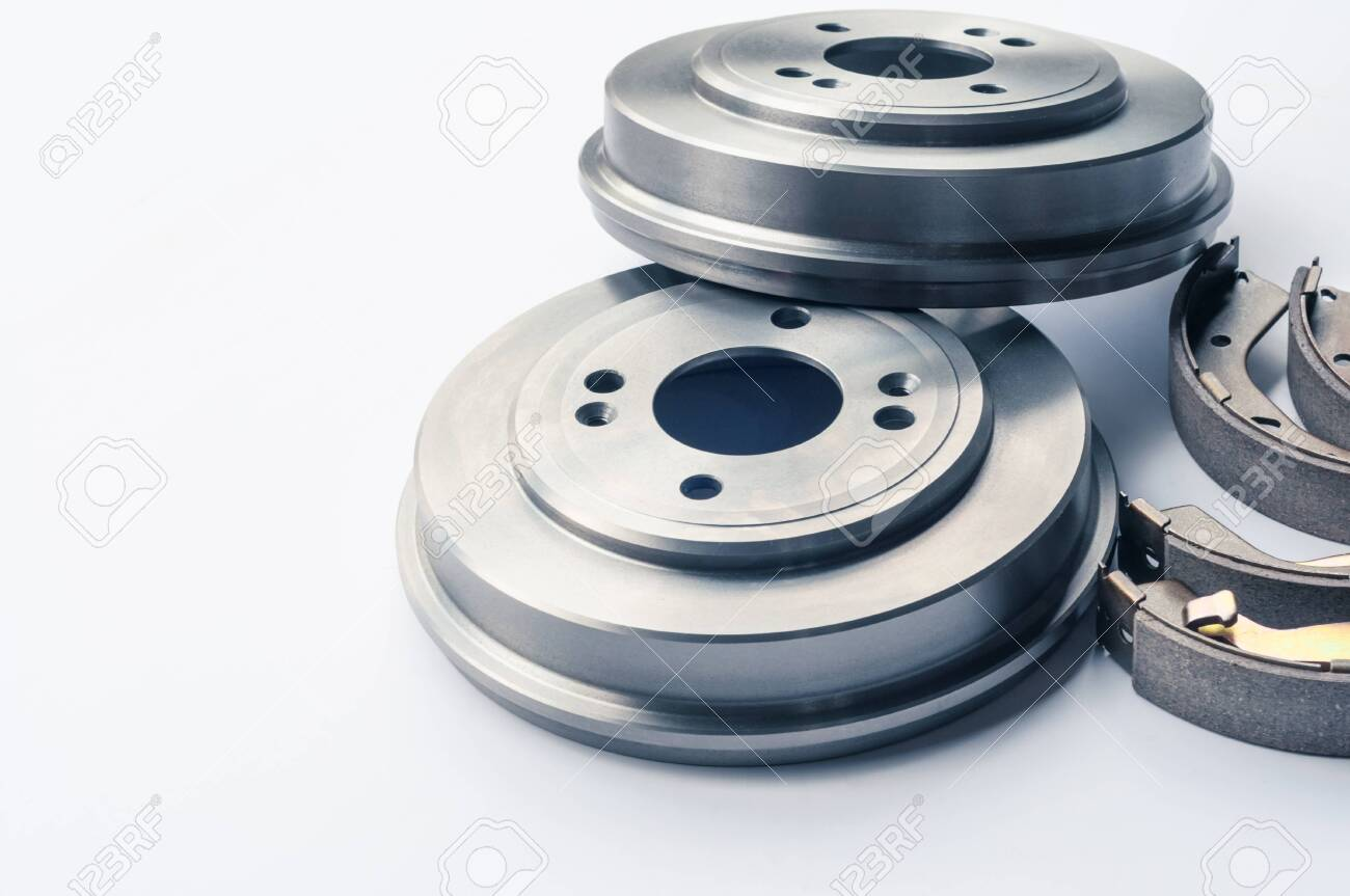 New auto parts brake drums, pads and cylinders on a white background - 130198393