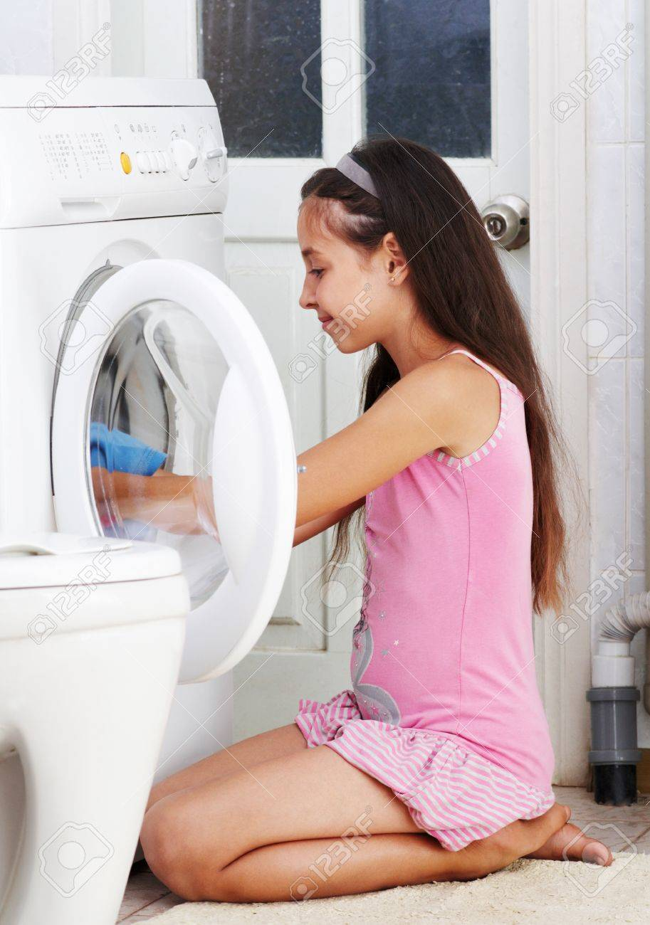 Photos of girl without any cloth in bathroom - Stock Photo The Beautiful Girl Is Washing Clothes In The Bathroom