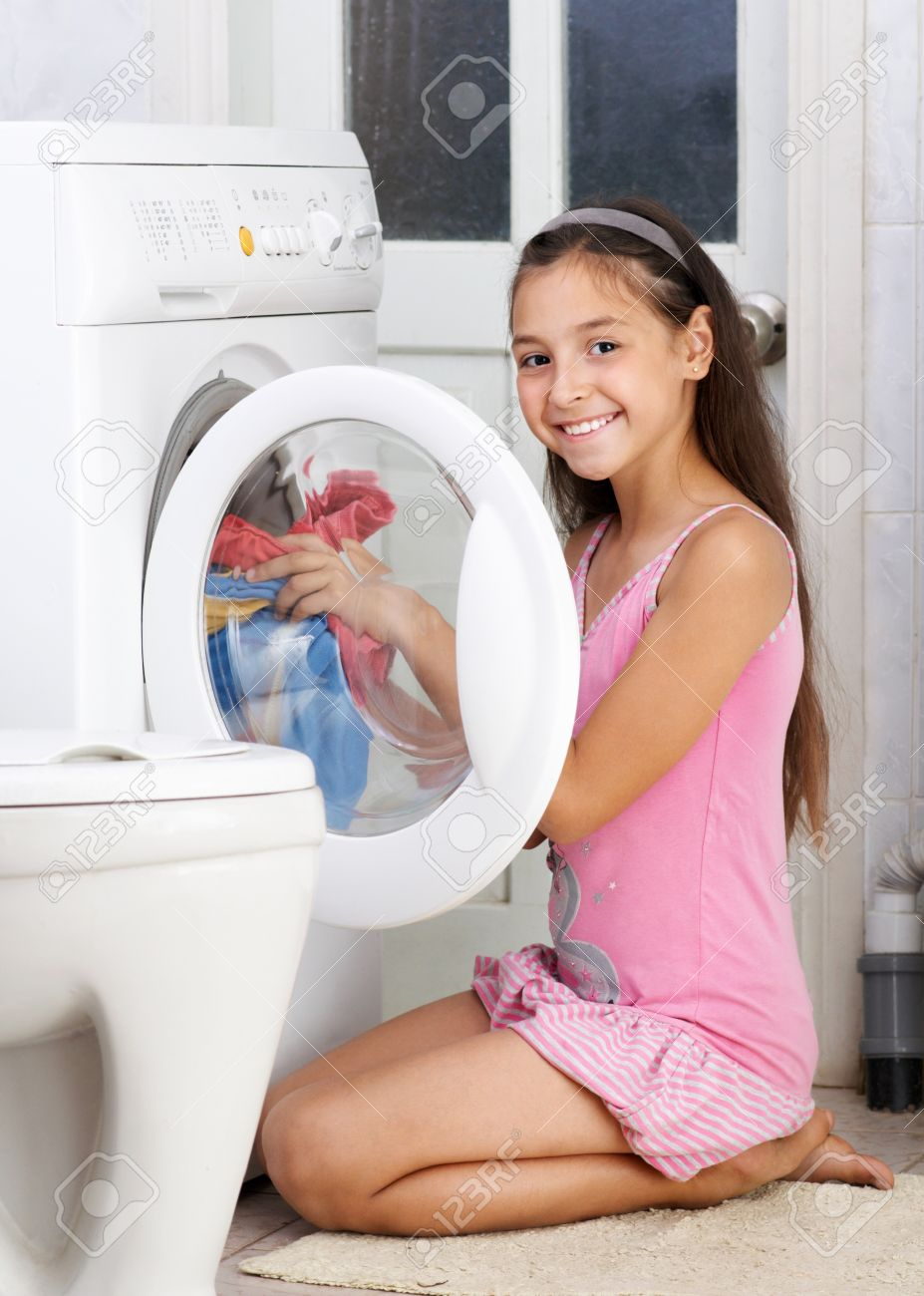 The young girl is washing clothes in the bathroom Stock Photo   16143005. The Young Girl Is Washing Clothes In The Bathroom Stock Photo