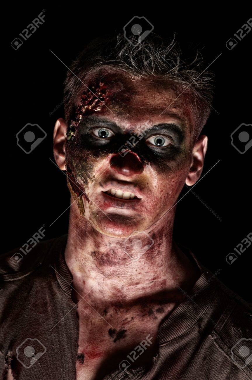 The angry zombie is monster in browm shirt in the studio Stock Photo - 16143145