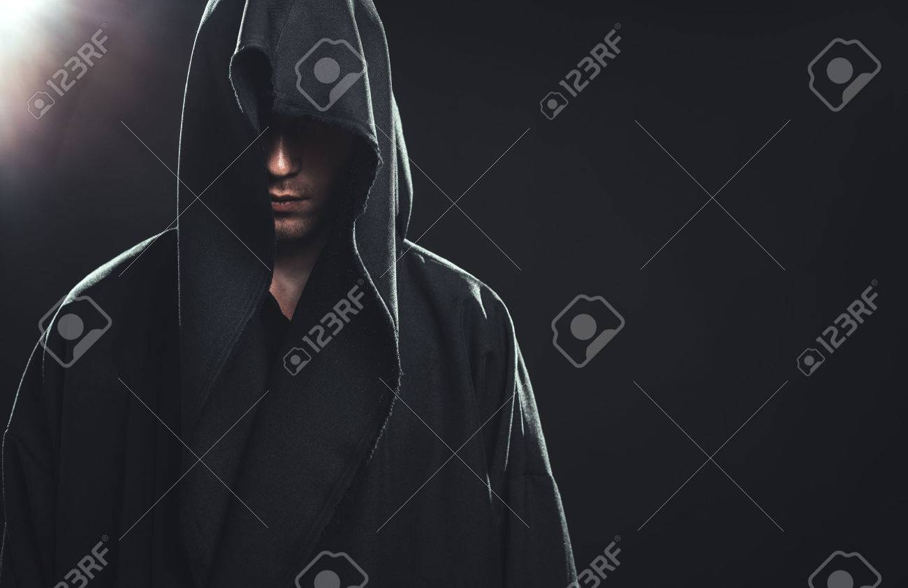 Portrait of a Man in a black robe on a dark background Stock Photo - 22794532