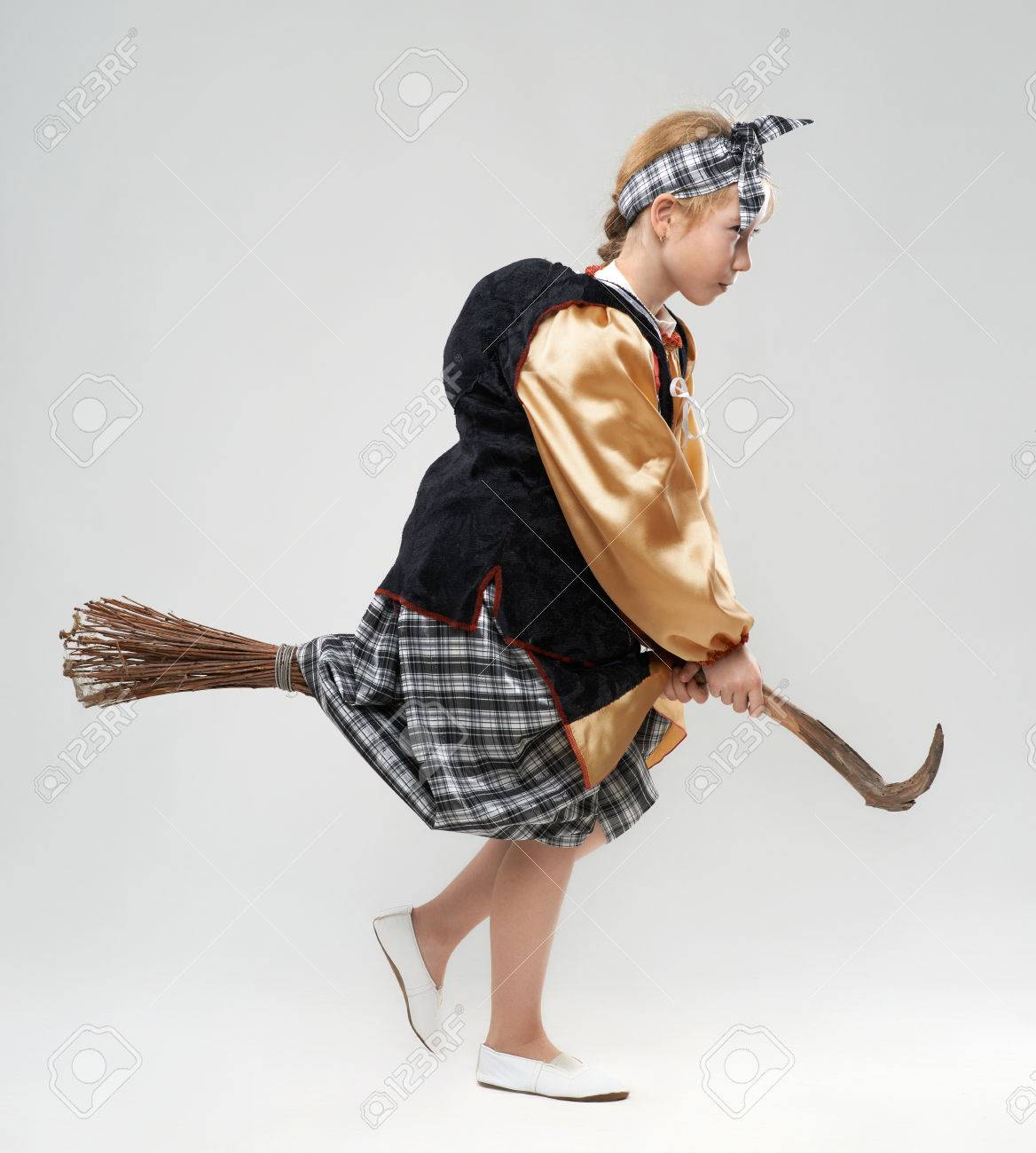 Funny Redhead Girl In Witch Costume Flying On A Broomstick Stock ...