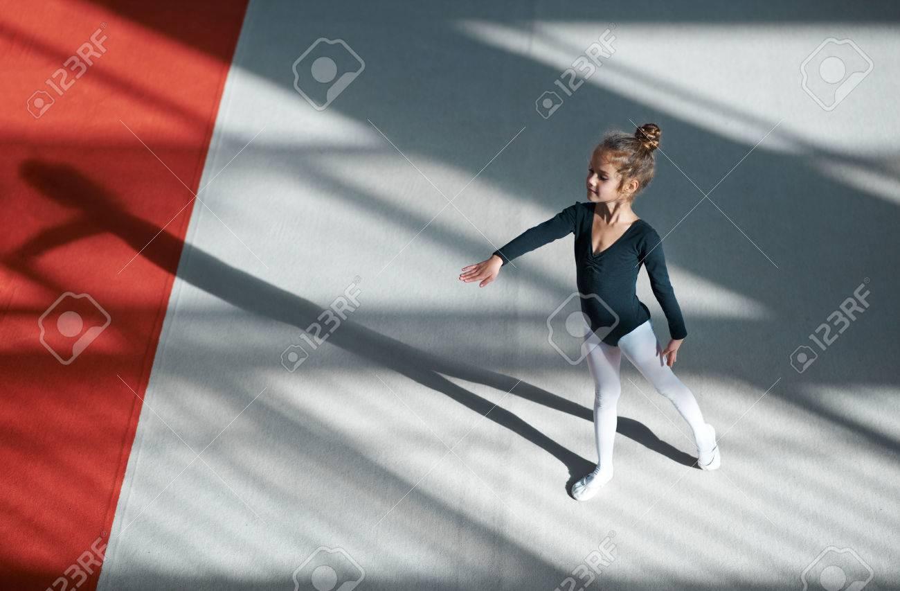 Girl practicing rhythmic gymnastics in the gym - 50927541
