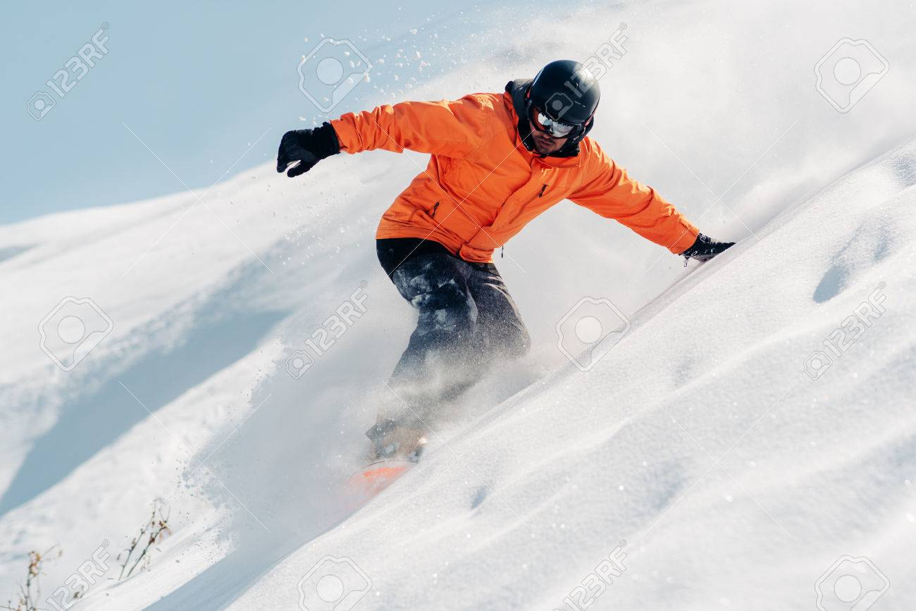 Snowboarder Is Riding With Snowboard From Powder Snow Hill Stock