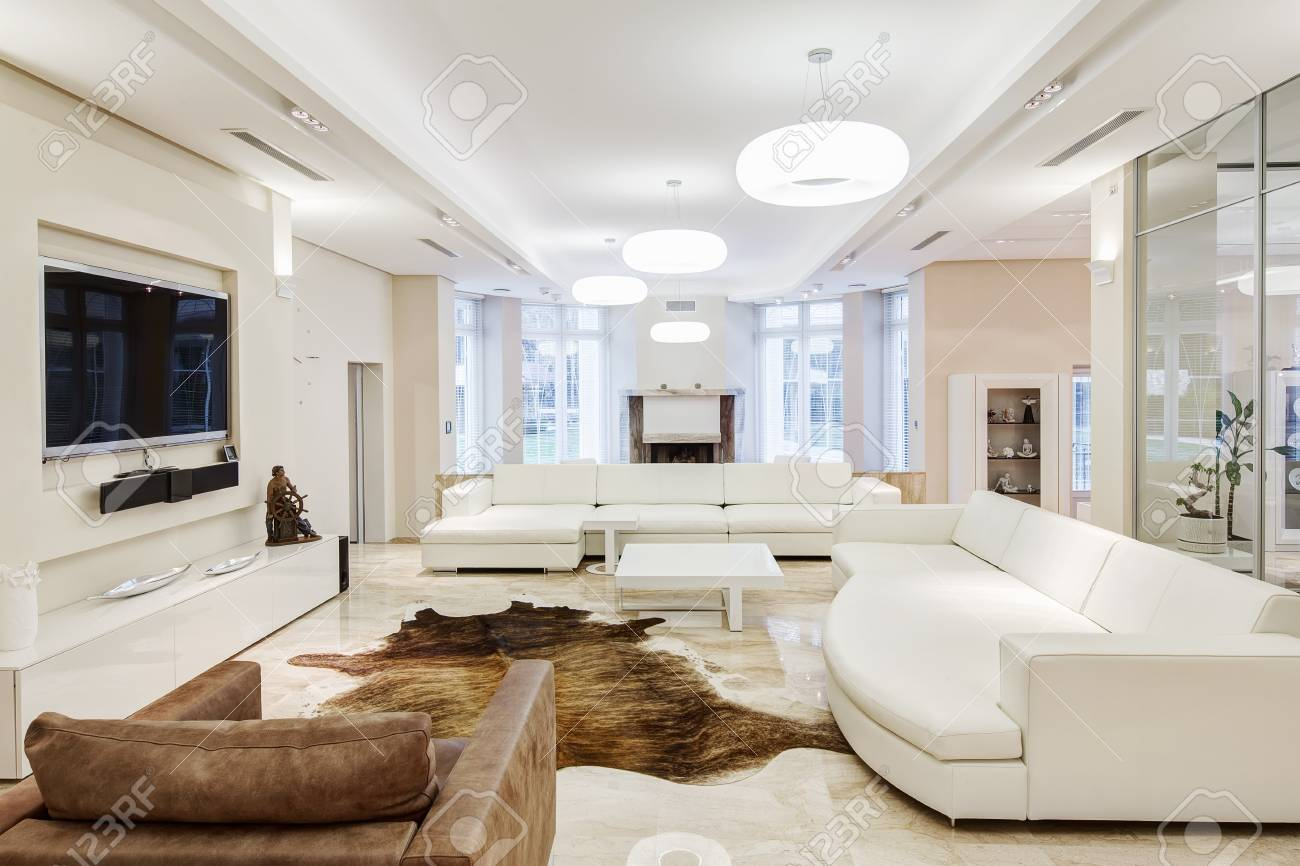 Big and comfortable living room with white interior in luxury..
