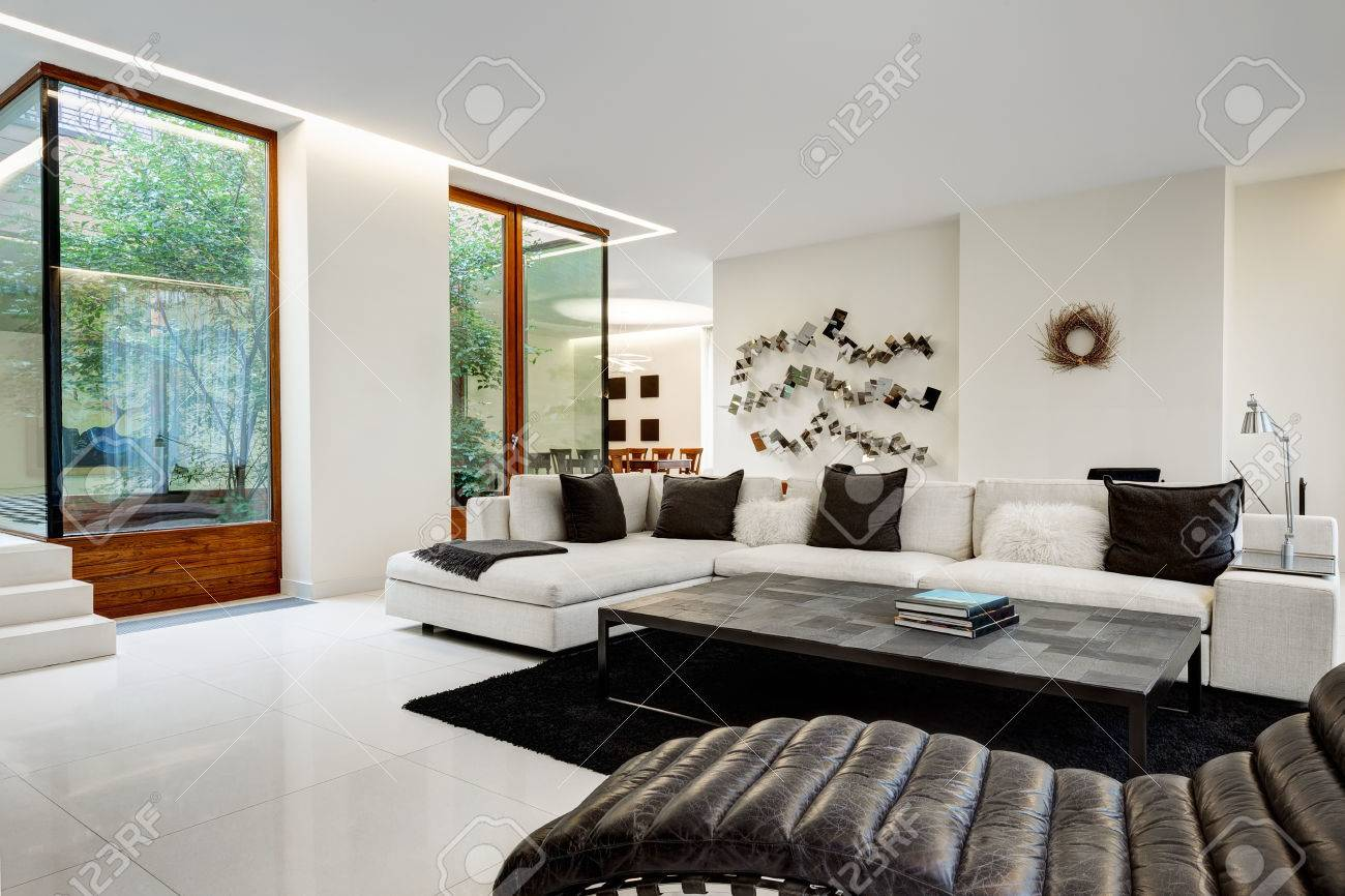 Large and comfortable living room with a white sofa in a luxurious..
