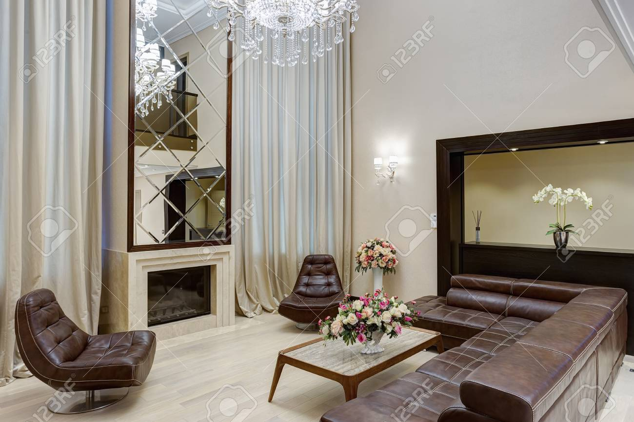 Living Room With Fireplace And Big Mirror Over Stock Photo