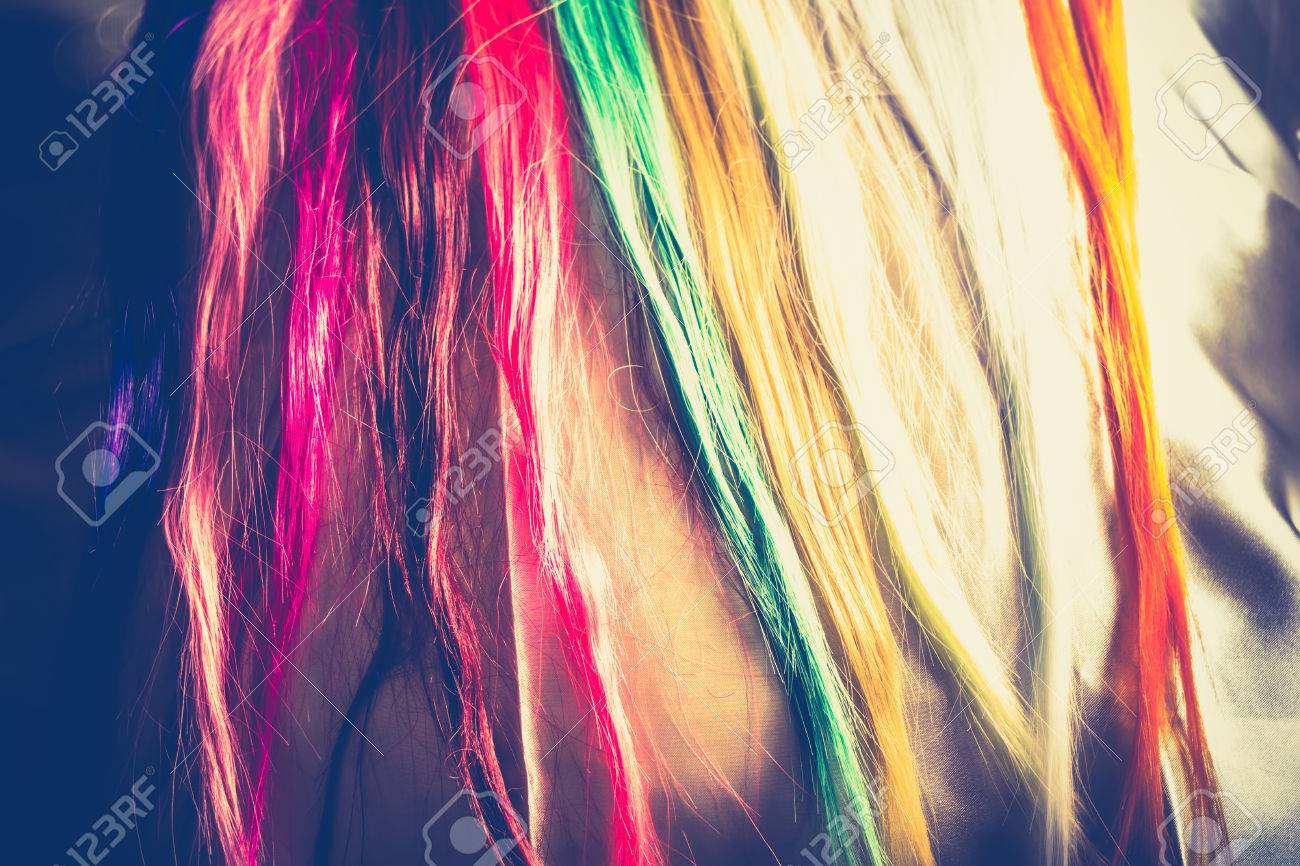 Synthetic Hair Extensions Of Different Colors Close Up Background