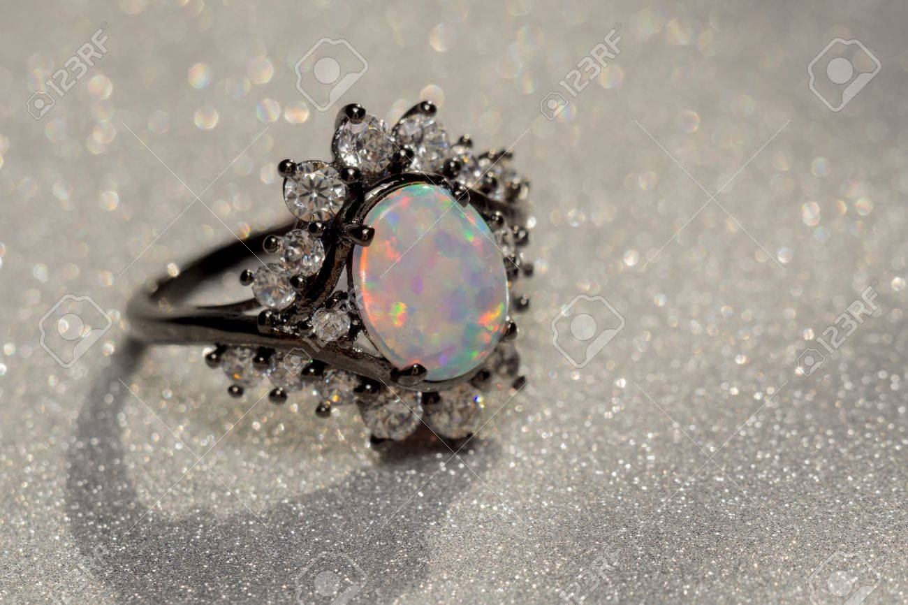 eddbbbbaf55c Fashion ring decorated with white fire opal stones. Stock Photo - 79288088