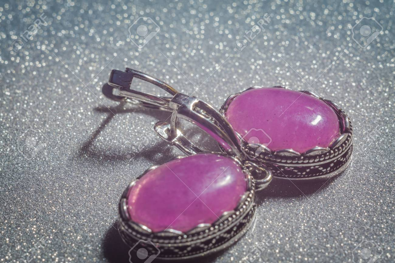 Stock Photo - Vintage silver jewelry with purple pink stone, kunzite, agate  or quartz.