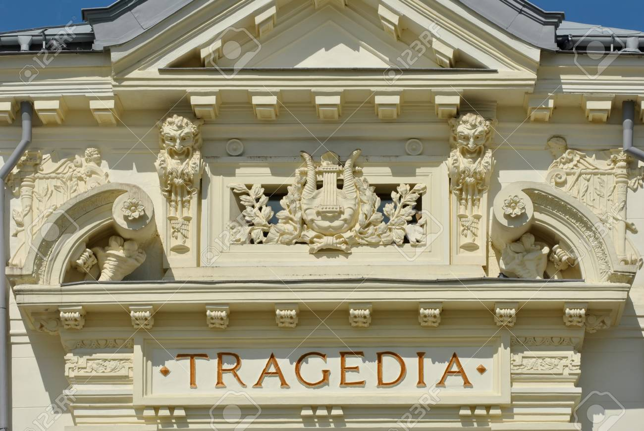 Theater building detail with tragedia inscription on the wall - 71281227