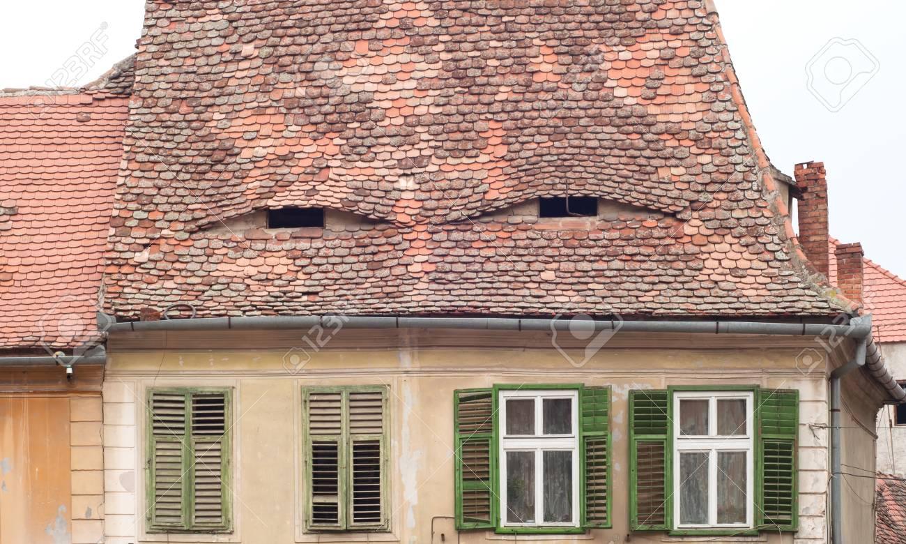 Vintage building from Sibiu, Romania with eye-like roof windows
