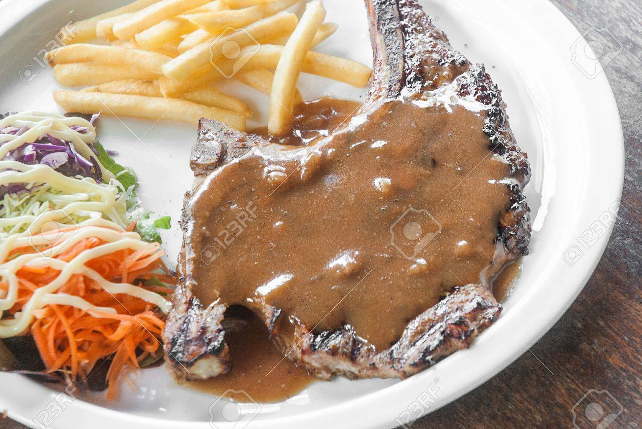 Fried Pork Chop Gravy Sauce Chips And Vegetable Salad Stock Photo 25839645