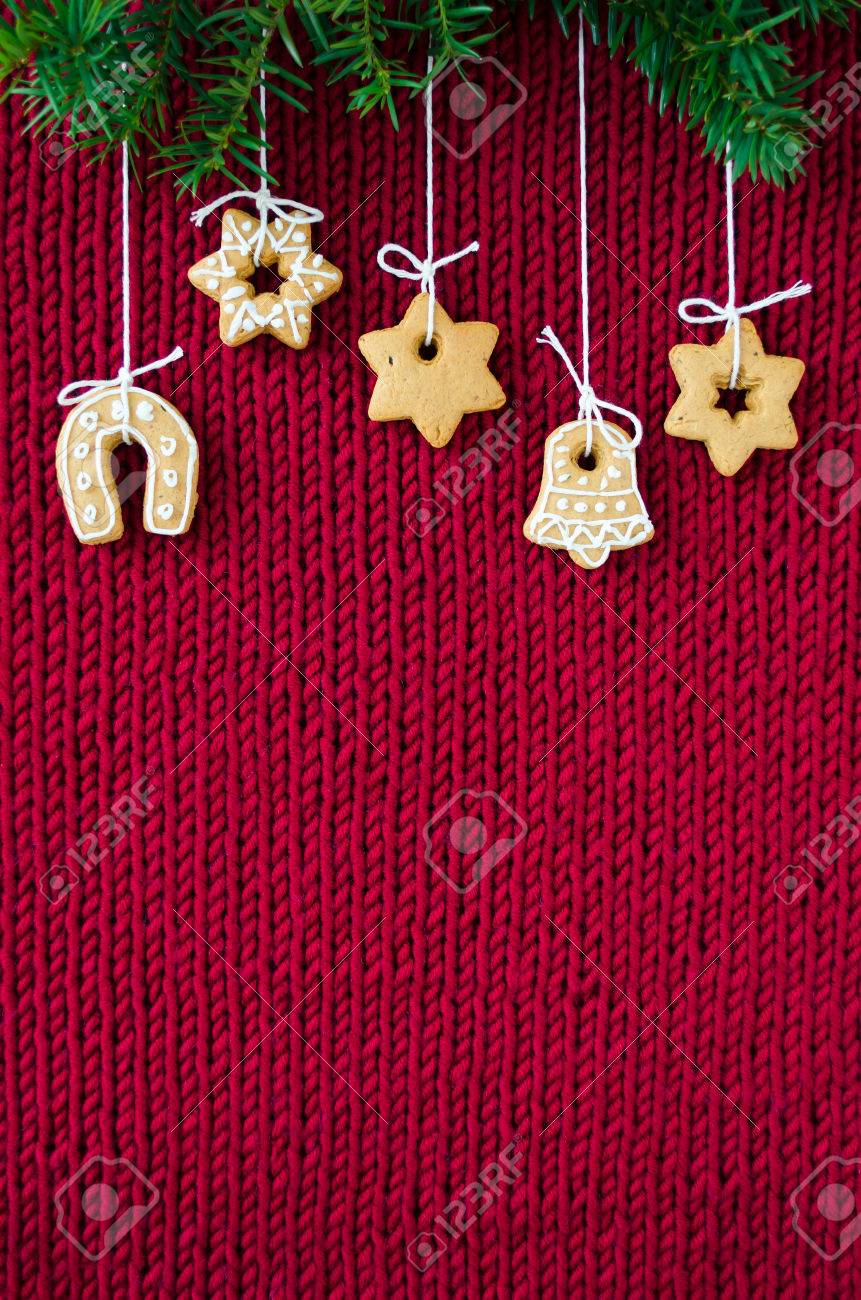 Christmas Cookies Hanging On Knitted Red Canvas Background Tree Branches Top Vertical