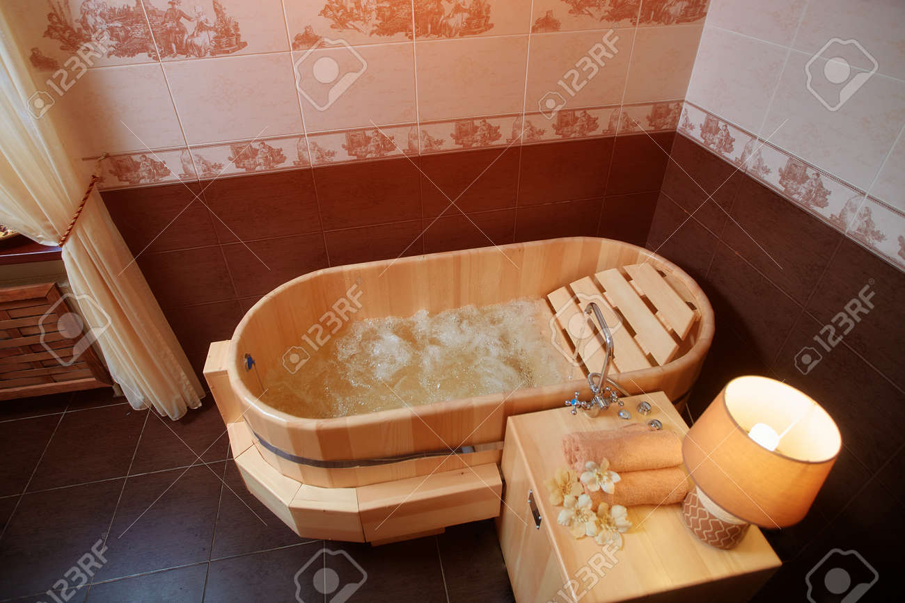 Wooden bath with hot water for Spa treatments and relaxation - 158618842
