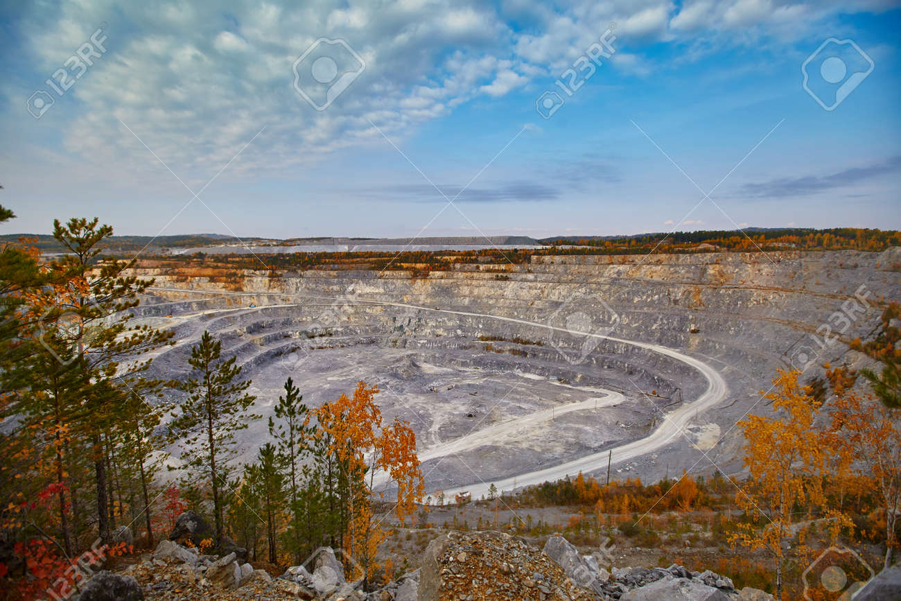 Top view of a huge crater of a stone crushed stone quarry in Russia, Chelyabinsk region, Miass city - 158618968
