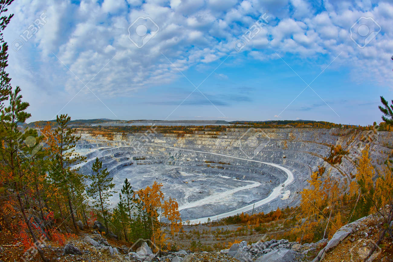 Top view of a huge crater of a stone crushed stone quarry in Russia, Chelyabinsk region, Miass city - 158618970