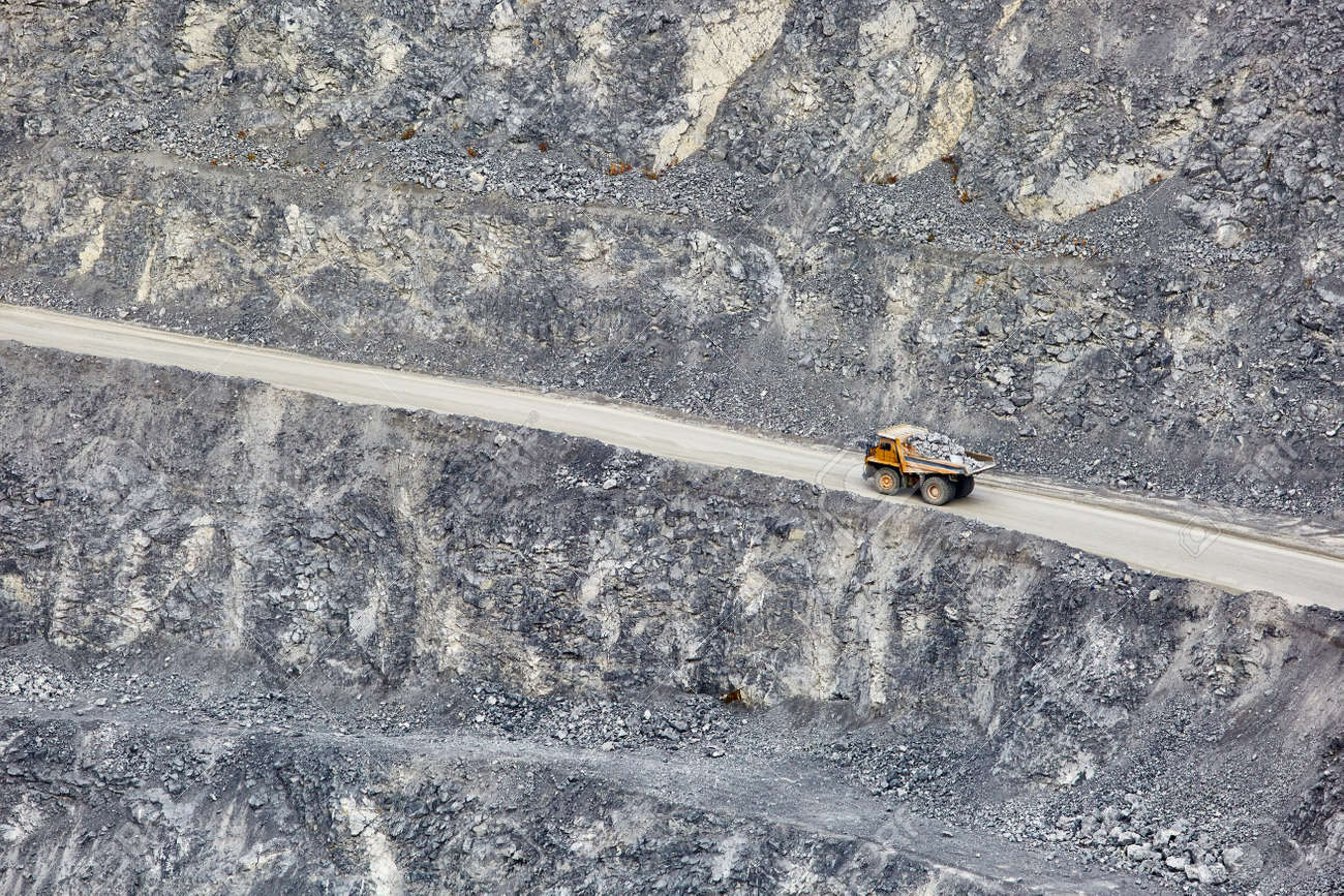 Top view of working BelAZ dump trucks in a stone and crushed stone quarry in Russia, Chelyabinsk region, Miass city. - 158618973