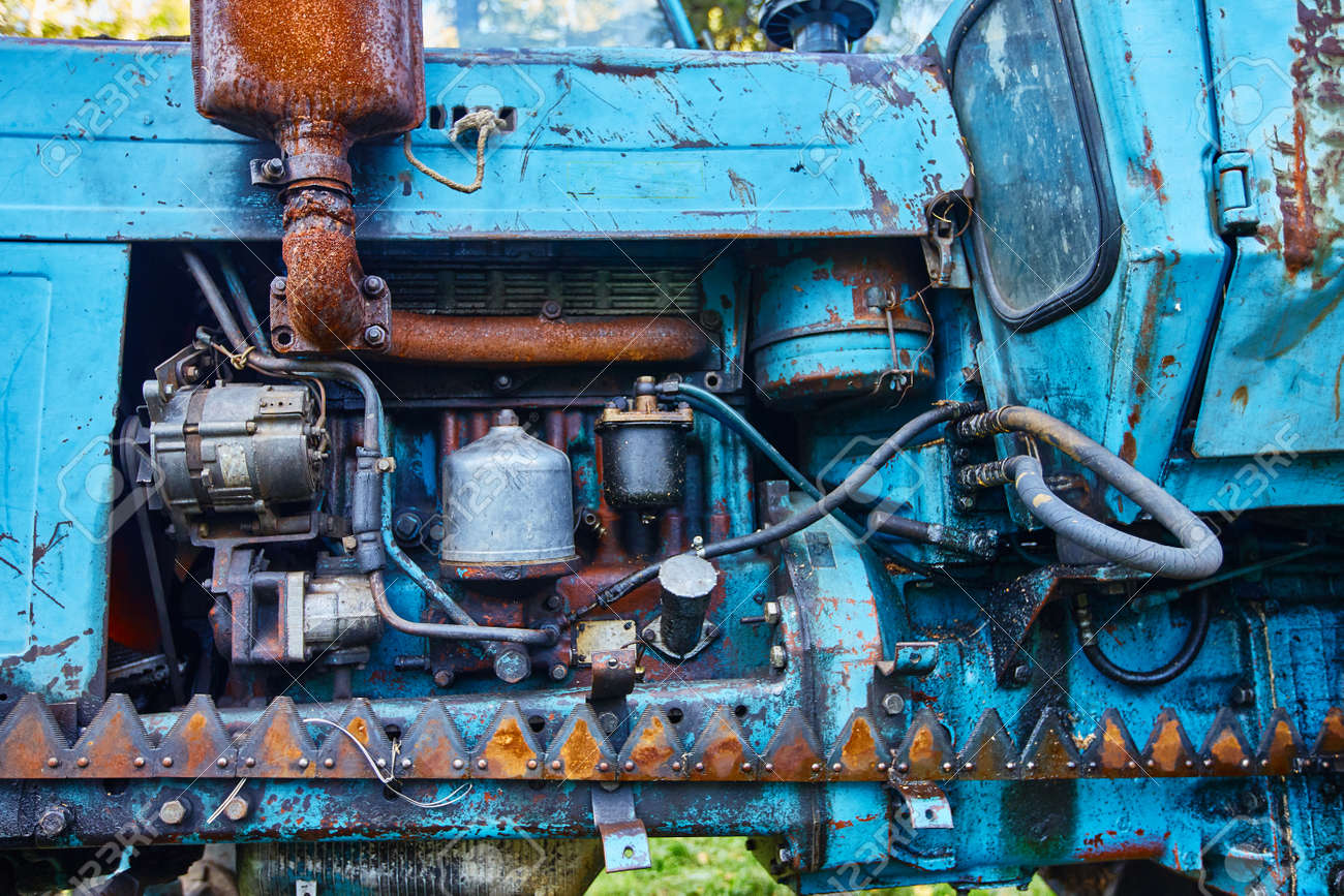 Front view of an old tractor engine. - 158648078