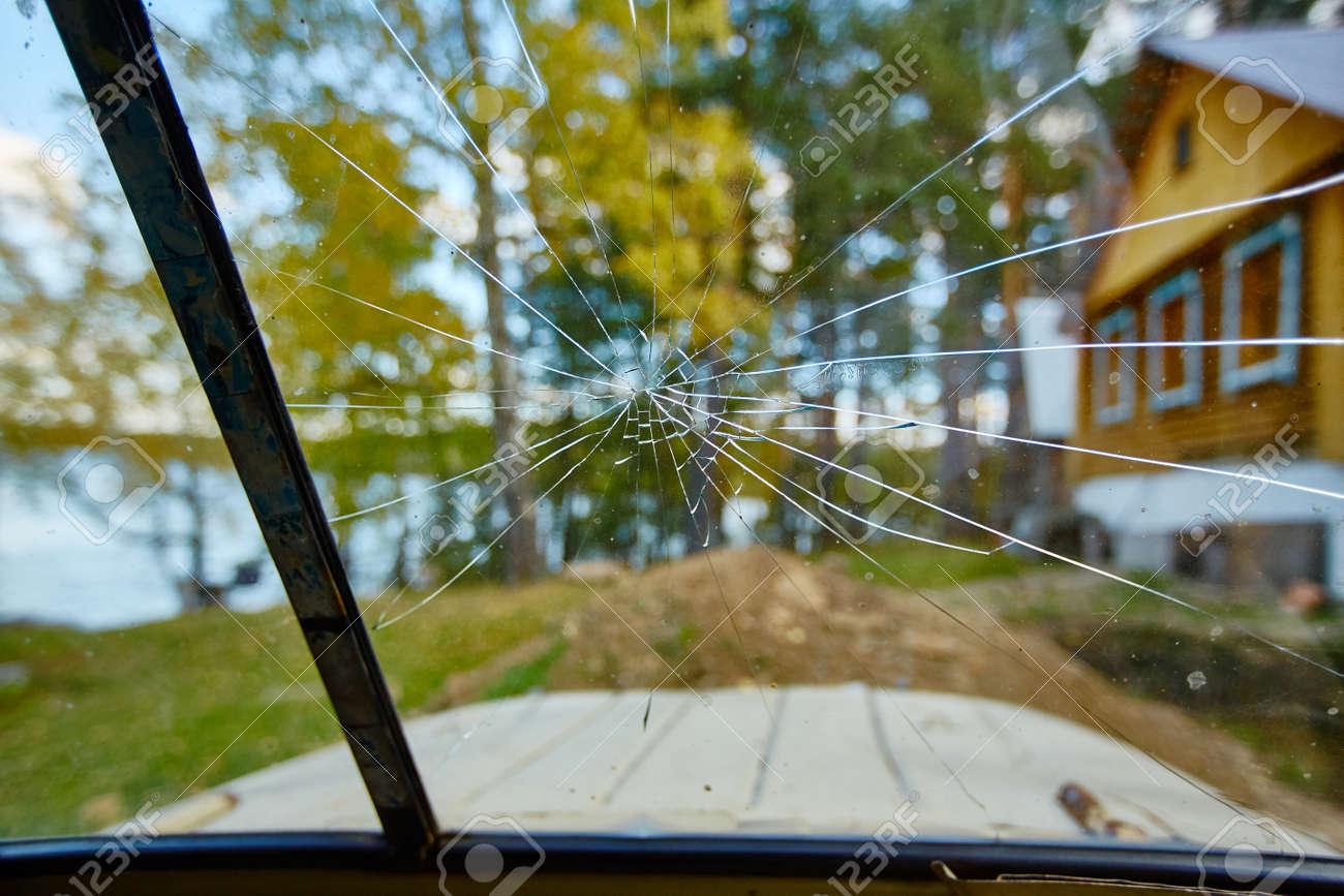 Cracked broken windshield close up. - 158639532