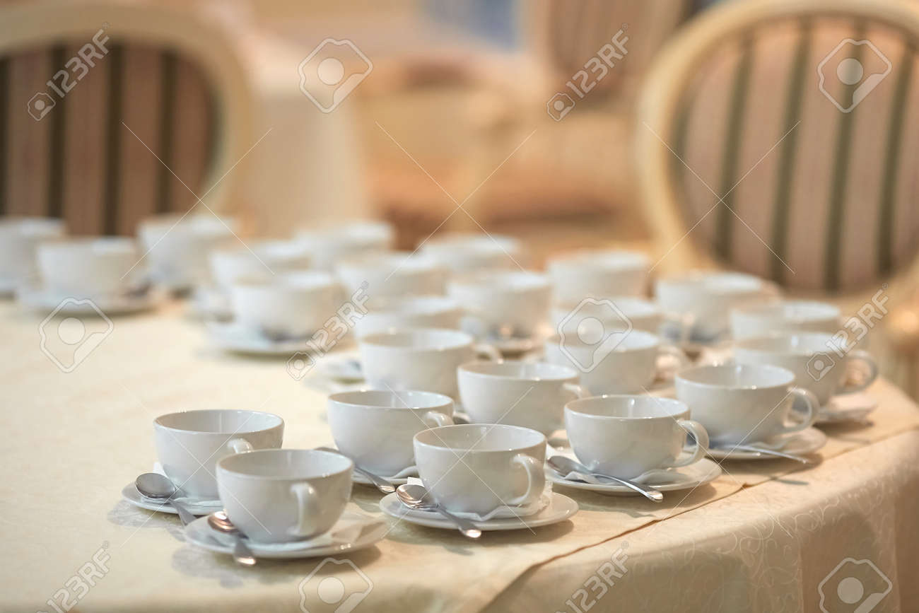 Rows of white coffee cups on the table - 158609320