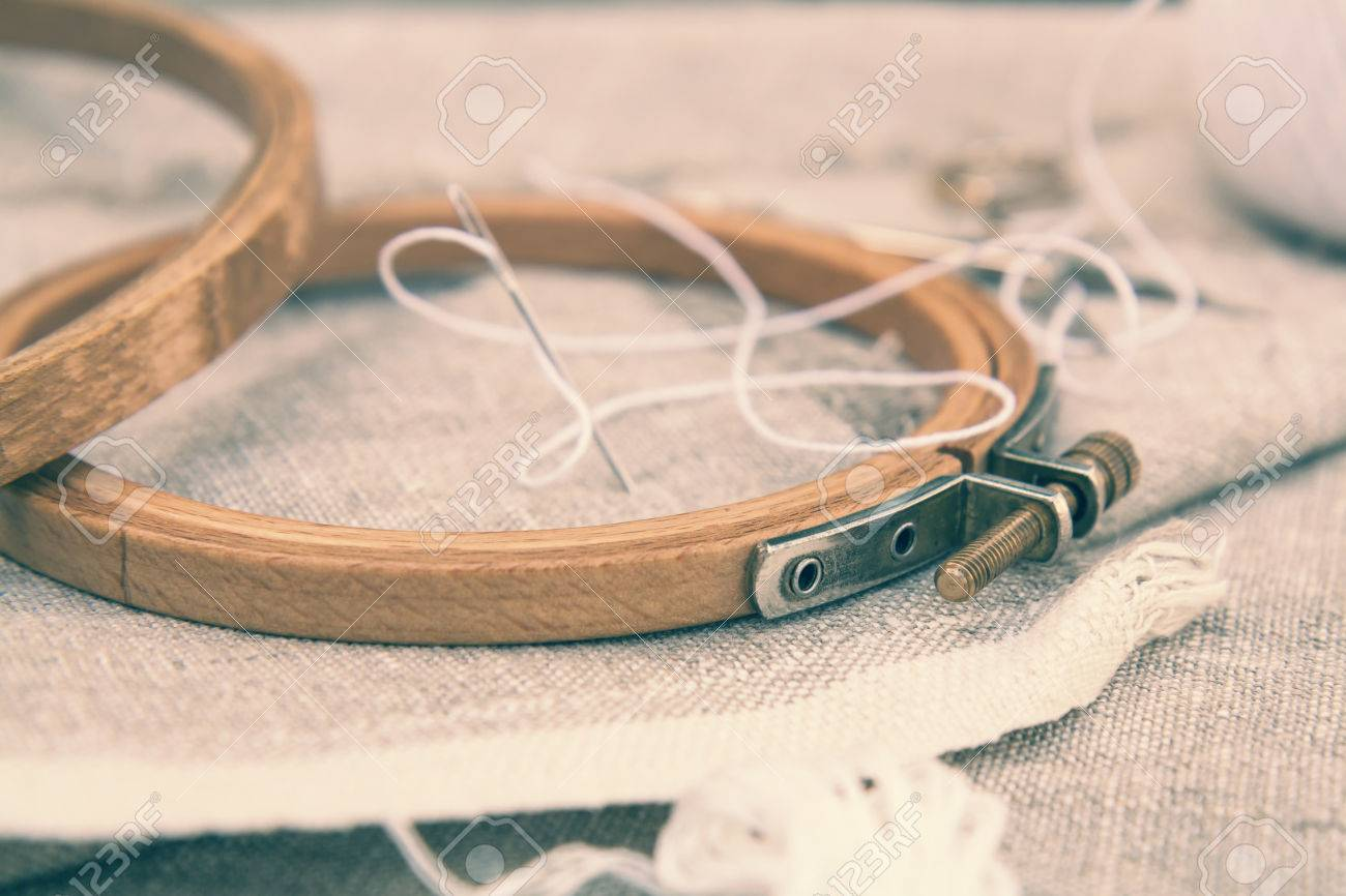 Set for embroidery, embroidery hoop and embroidery thread. Coloring and processing photos in vintage style with soft selective focus. Shallow depth of field Stock Photo - 60792720