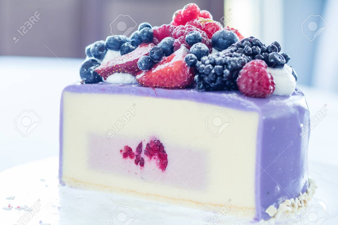 Tasty Ice-cream cake with fresh berries on a glass plate. Light background. Shallow depth of field Stock Photo - 92987254