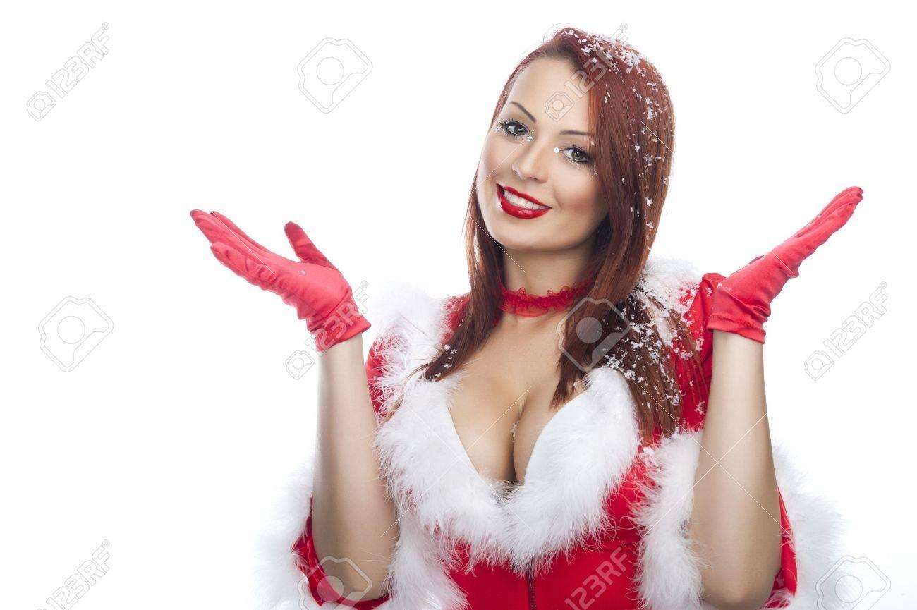 Happy friendly woman blowing snowflakes in winter season Stock Photo - 17257424