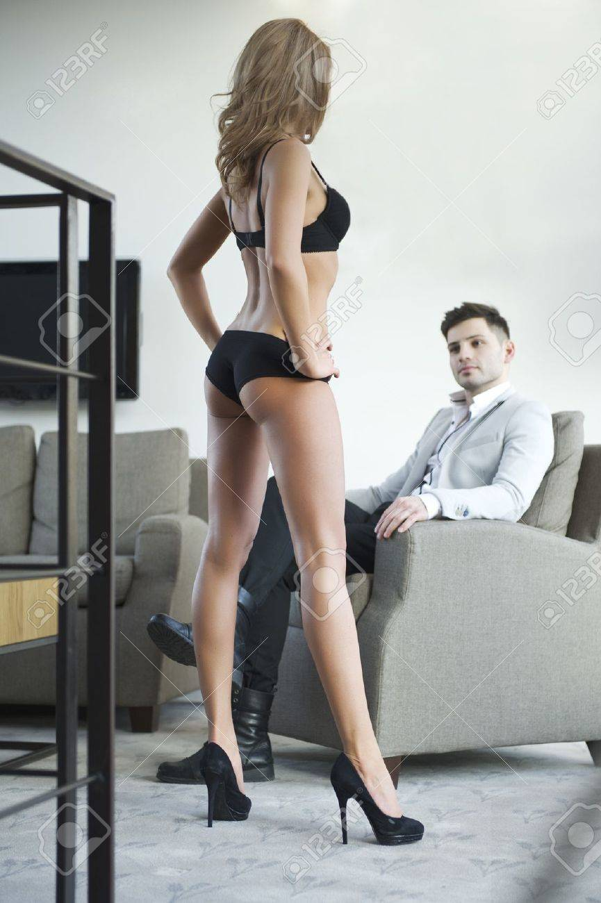 Sexy young couple in room Stock Photo - 21375007