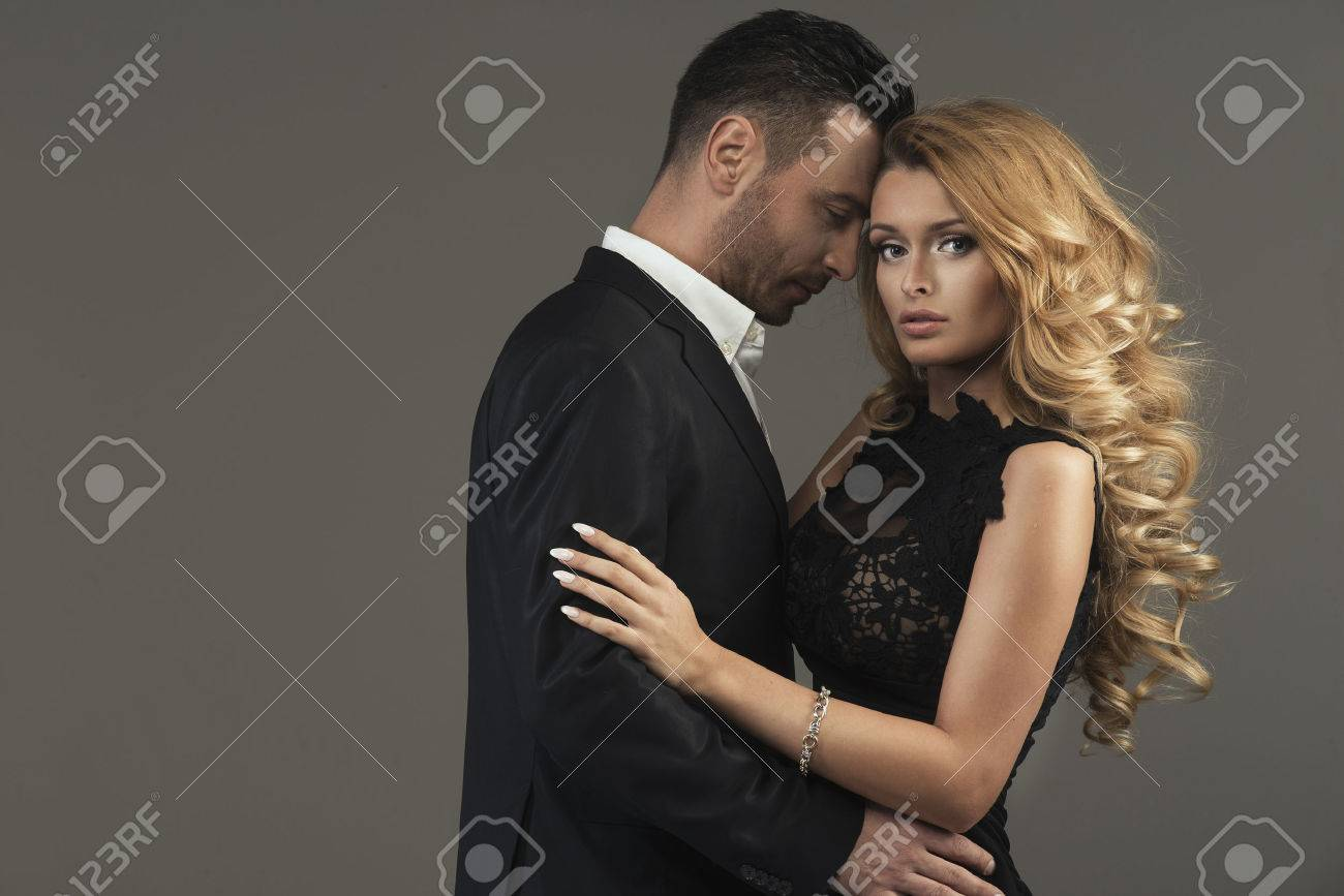 portrait of a young fashion couple looking into the camera Stock Photo - 42756445