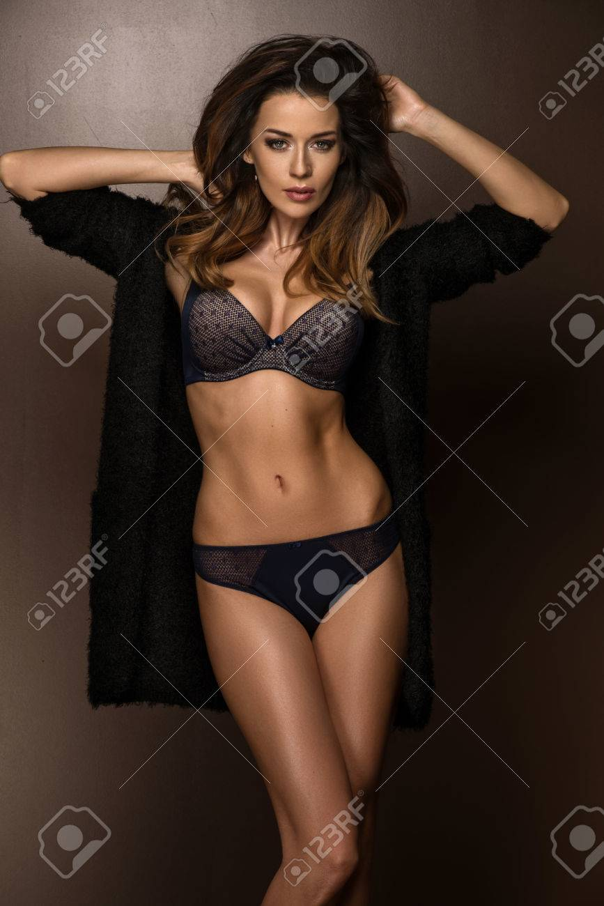 30db80425 Portrait of young brunette woman in dark lingerie Stock Photo - 60613867