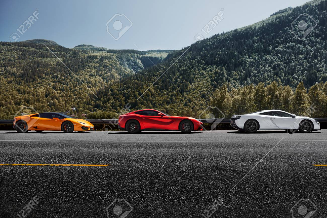 Miland, Norway. 04.06.2016 Yellow Lamborghini Huracan, Red Ferrari..