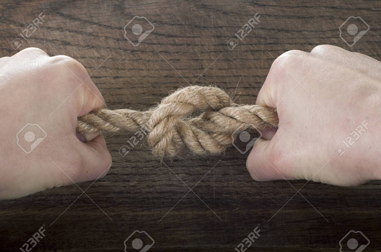 Rope knot as a strong nautical marine line tied together as a rope knot as a strong nautical marine line tied together as a symbol for trust and biocorpaavc Choice Image