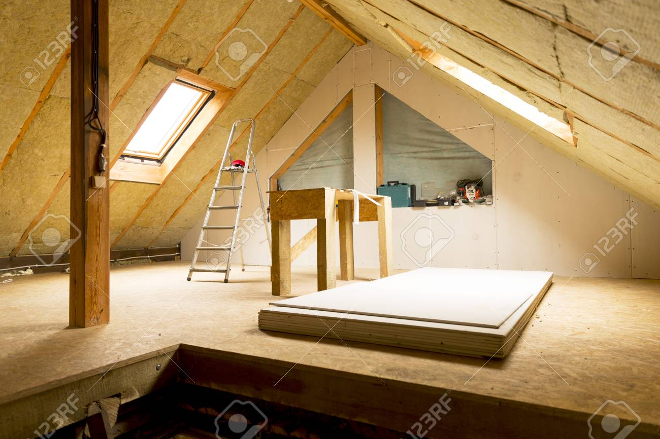 house attic under construction mansard wall insulation with rock wool - 91379068