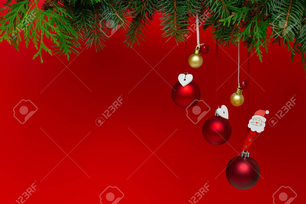 Christmas decorations on a red background. Holiday season concept - 137406404