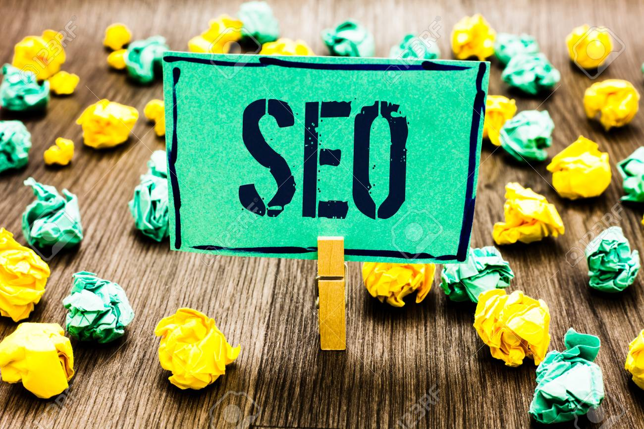 Conceptual hand writing showing Seo. Business photo showcasing Search engine optimization increase in online marketing channel Crumpled papers ideas mistakes paperclip clip objects wood - 104193122