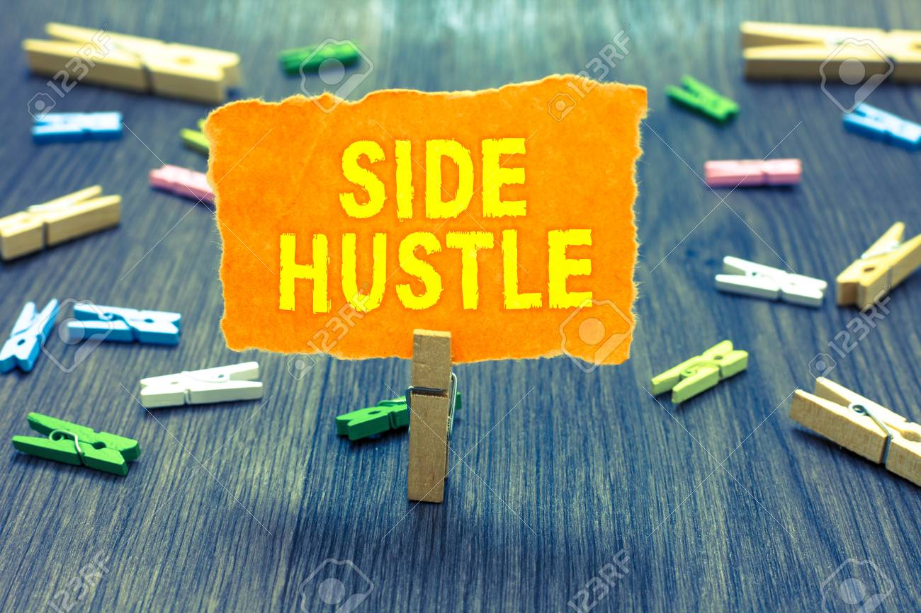 Conceptual hand writing showing Side Hustle. Business photo text way make some extra cash that allows you flexibility to pursue Clothespin holding orange paper note clothespins wooden floor - 106757257