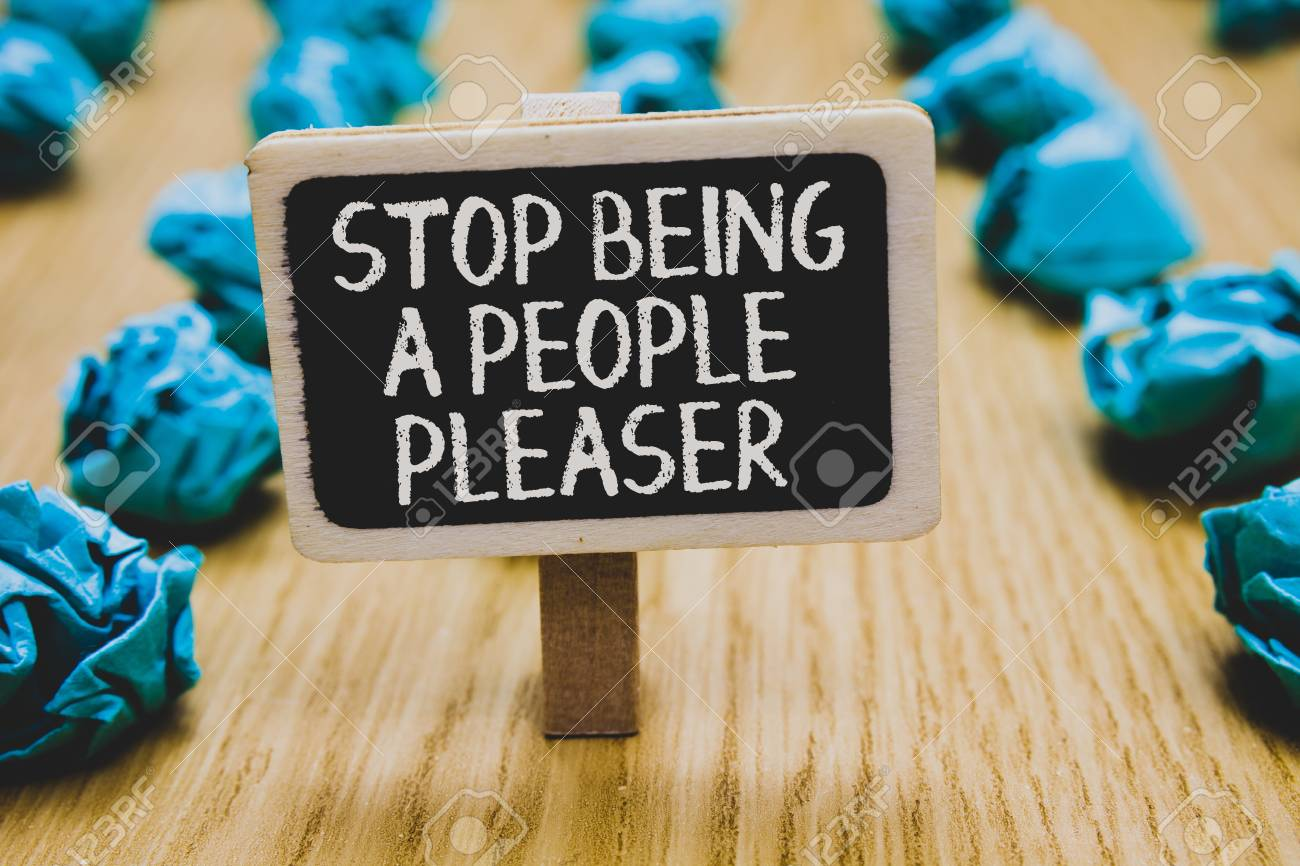 Handwriting text writing Stop Being A People Pleaser. Concept meaning Do what you like not things other people want Stand blackboard with white words behind blurry blue paper lobs woody floor - 108645843