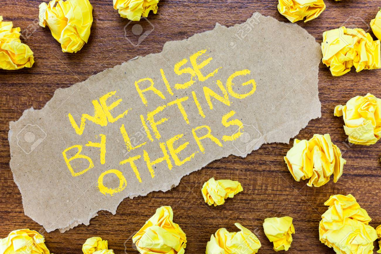 Word writing text We Rise By Lifting Others.. Business concept for Team Spirit we feel Abundant with possibility. - 110892195