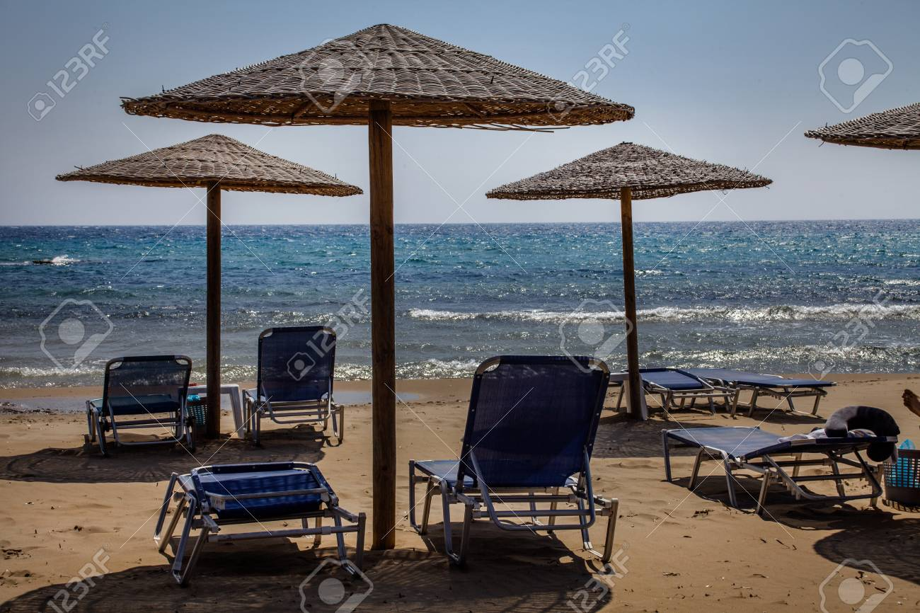 Beach Adjustable Lounge Chair Bed Facing The Ocean Wooden Umbrella Stock Photo Picture And Royalty Free Image Image 115229395