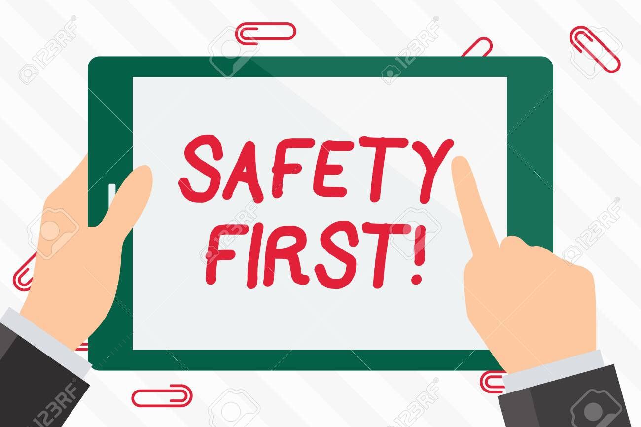 Text sign showing Safety First. Business photo showcasing best avoid any unnecessary risks and act so that you stay safe Hand Holding Pointing Touching Blank Rectangular Color Tablet White Screen - 120201916