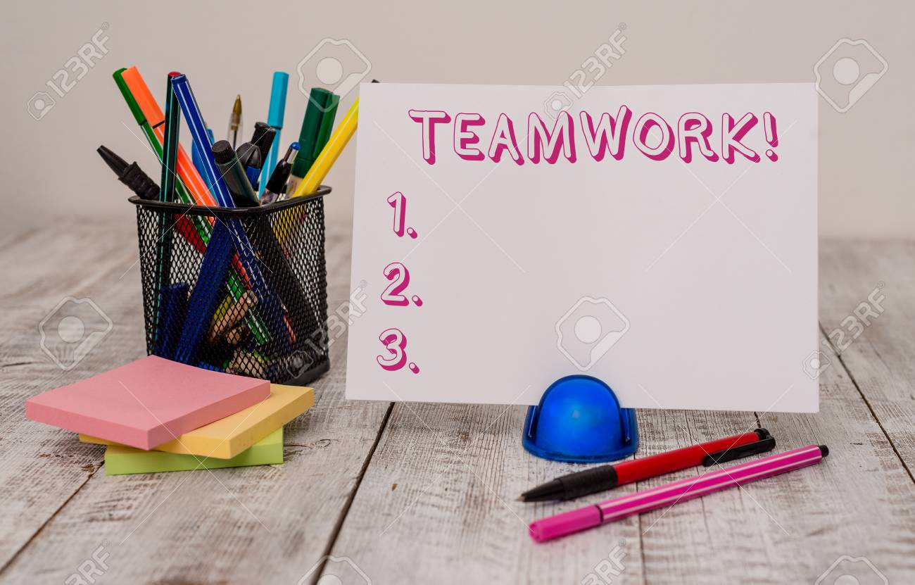 Writing note showing Teamwork  Business concept for combined