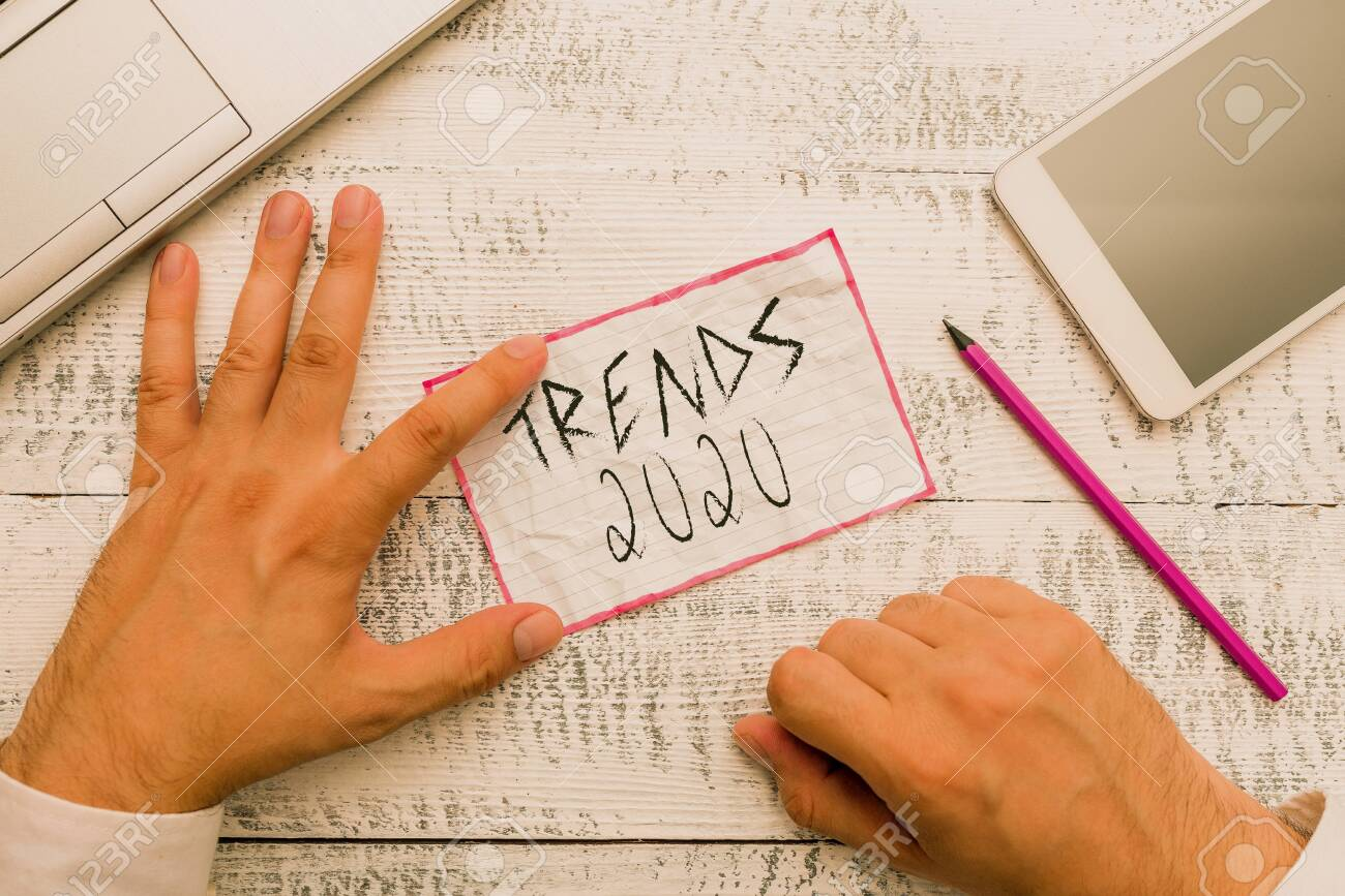 Upcoming Trends 2020.Writing Note Showing Trends 2020 Business Concept For Upcoming