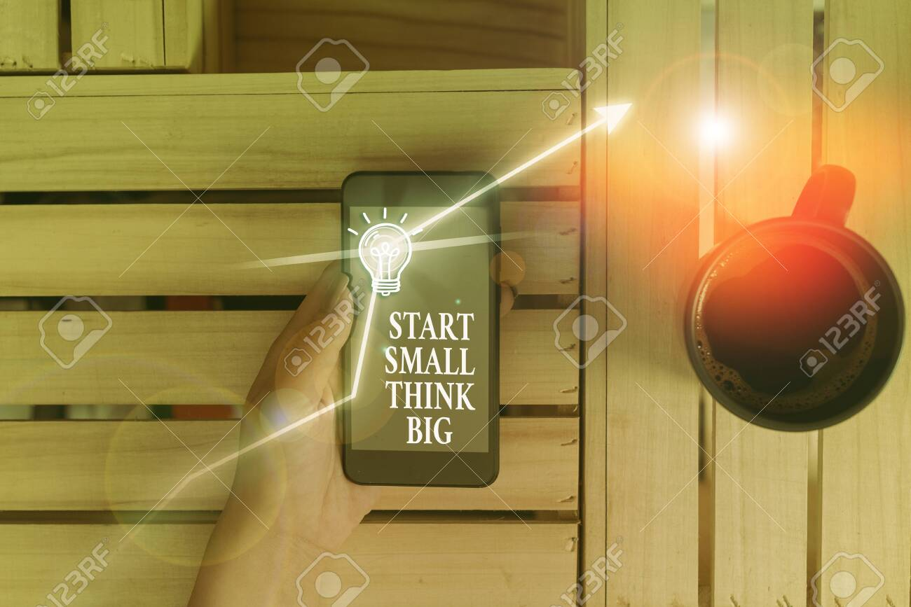 Conceptual hand writing showing Start Small Think Big. Concept meaning Initiate with few things have something great in mind - 136960920