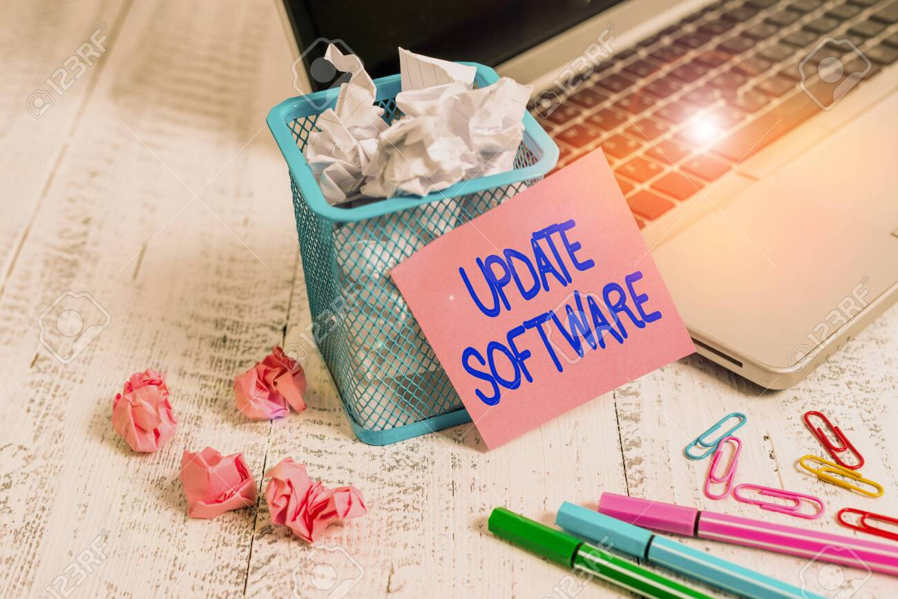 Word writing text Update Software. Business photo showcasing adds minor software enhancements and compatibility Laptop sticky note waste basket crushed paper ball clips pens vintage table - 140070980