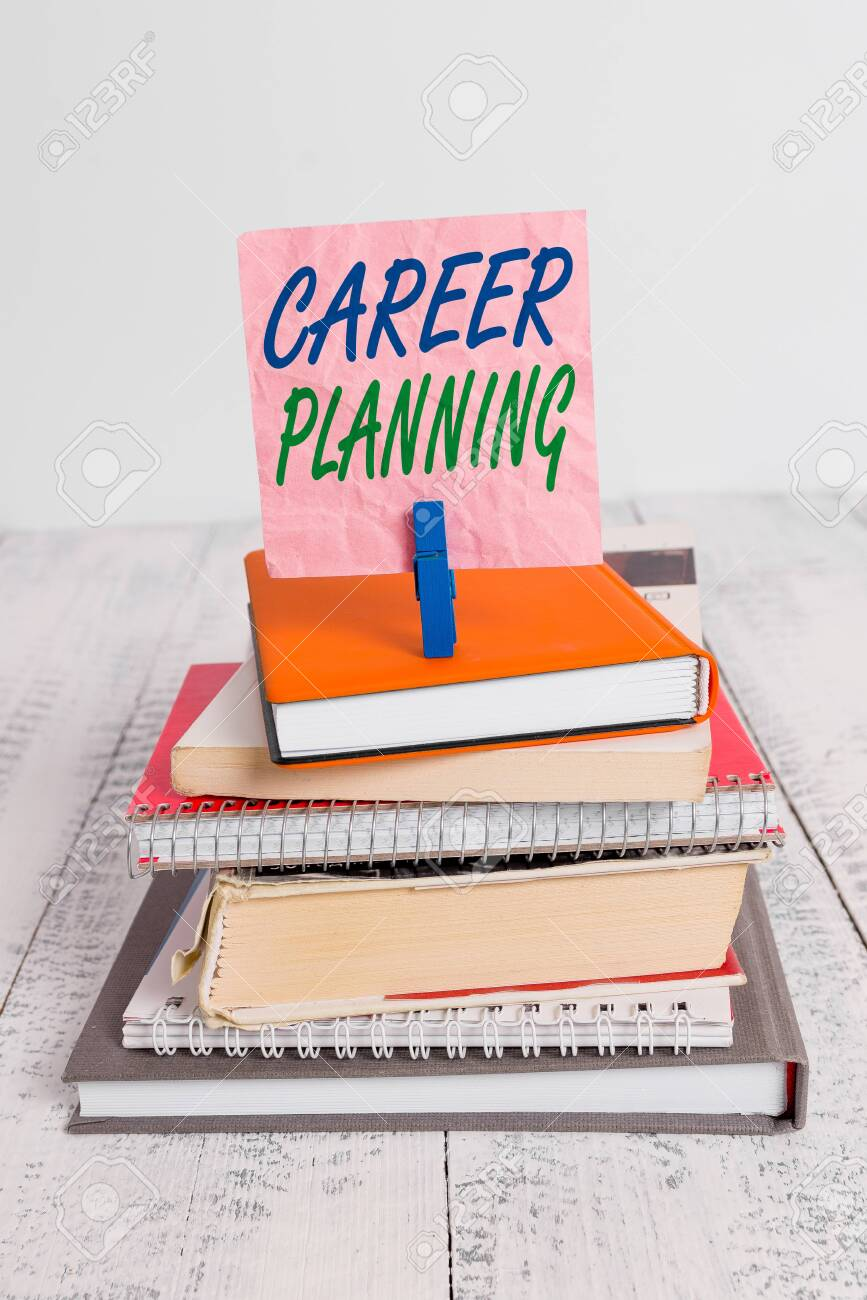 Word writing text Career Planning. Business photo showcasing Strategically plan your career goals and work success pile stacked books notebook pin clothespin colored reminder white wooden - 143275249