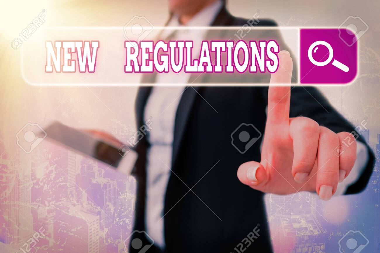 Writing note showing New Regulations. Business concept for Regulation controlling the activity usually used by rules. - 146598515