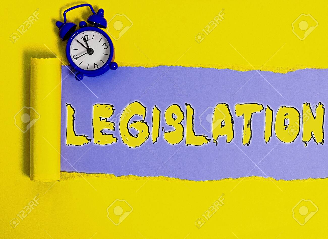 Word writing text Legislation. Business photo showcasing the exercise of the power and function of making rules Rolled ripped torn cardboard placed above a wooden classic table backdrop - 153407281