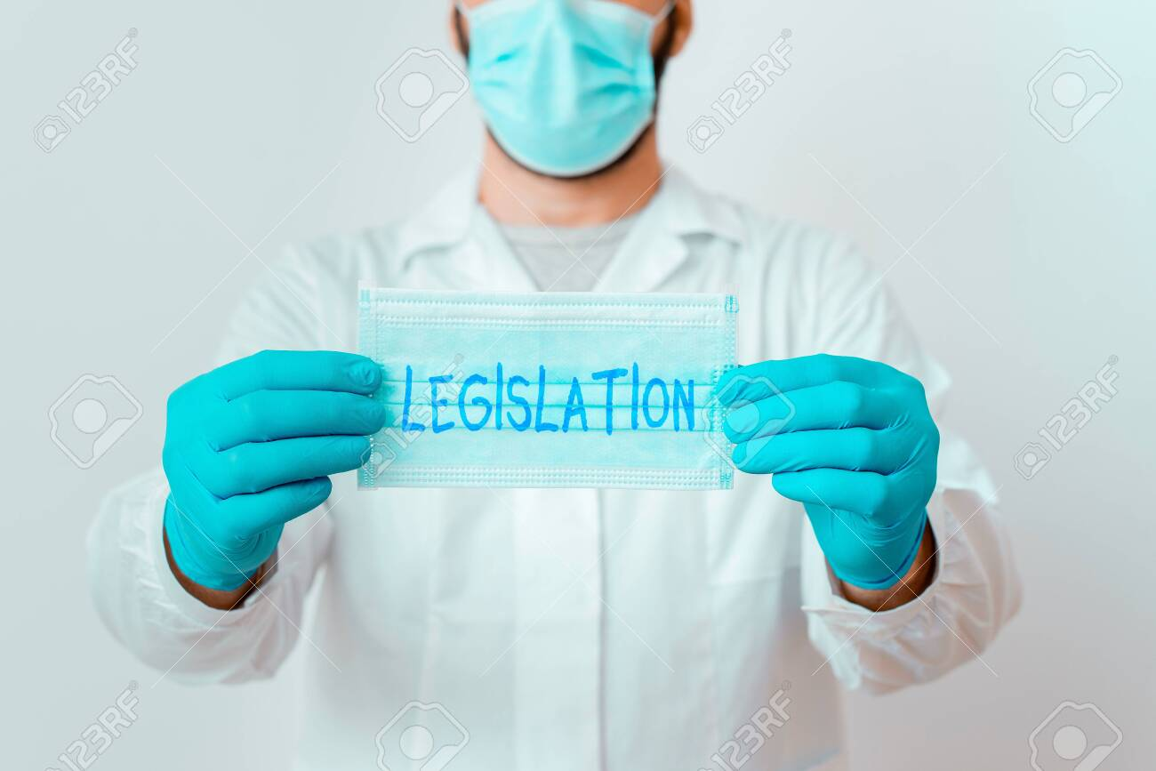 Writing note showing Legislation. Business concept for the exercise of the power and function of making rules Laboratory Technician Featuring Sticker Paper Smartphone - 153408992