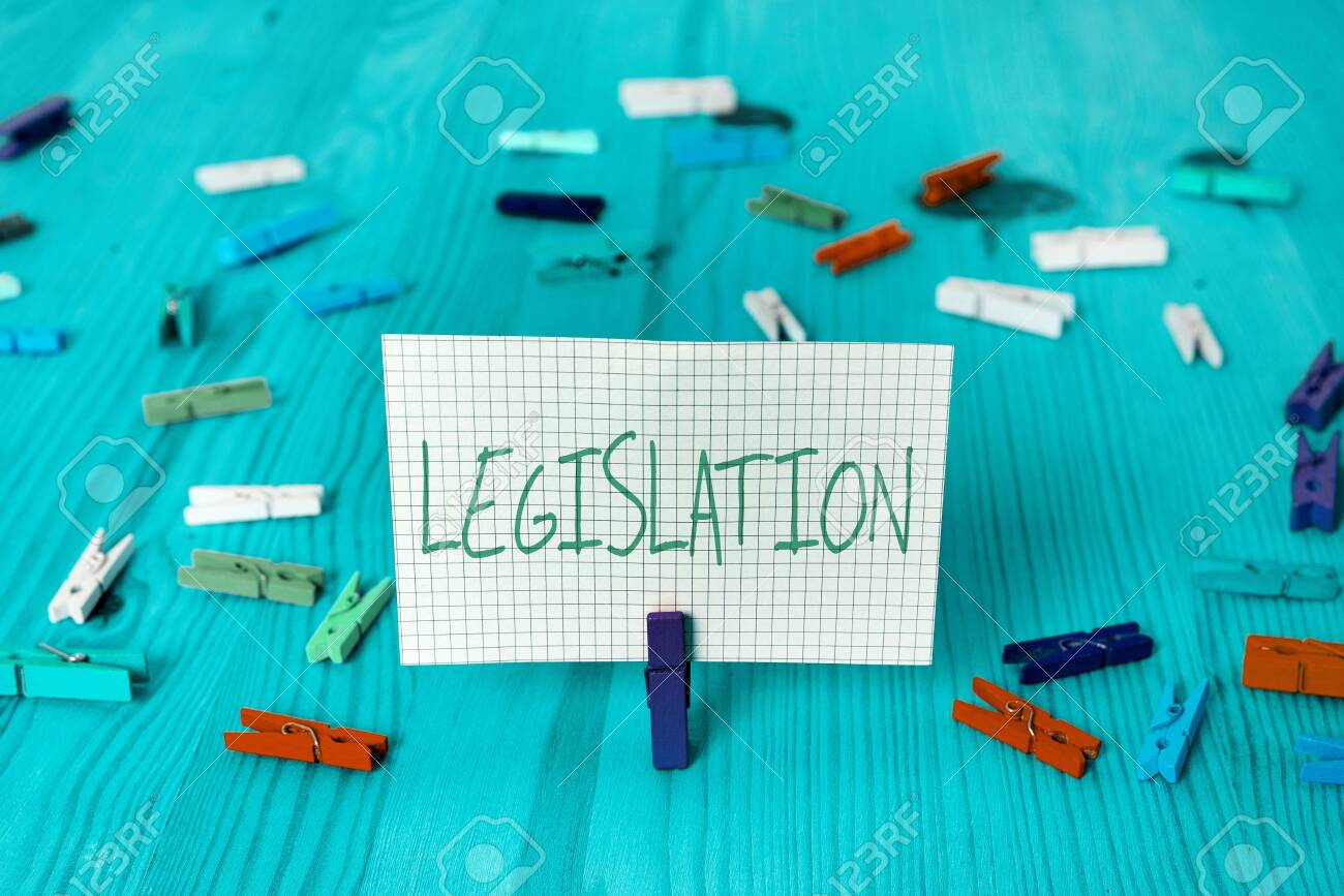 Conceptual hand writing showing Legislation. Concept meaning the exercise of the power and function of making rules Colored crumpled rectangle shape paper light blue background - 153418459